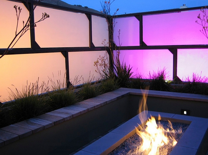 Mesmerizing hues of the sandblasted glass panels and the firepit create a romantic setting