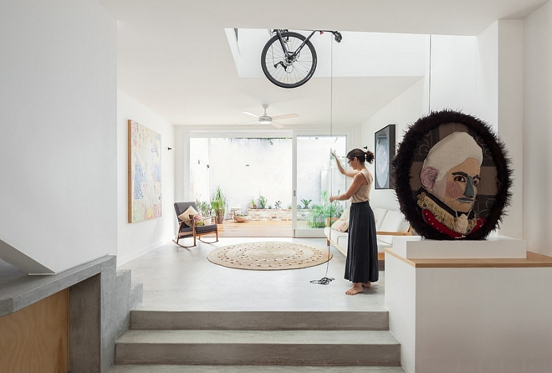Modern home with the bikes hanging from the ceiling in a double height void