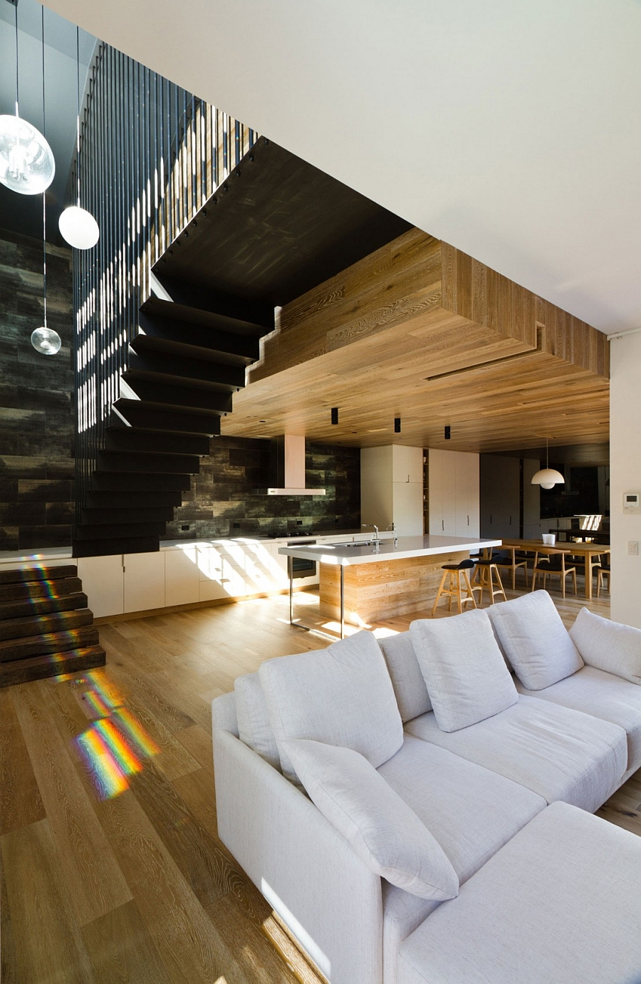 Modern interior with a high ceiling and warm wooden surfaces