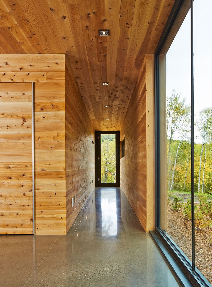 Narrow entry draped in wood panels