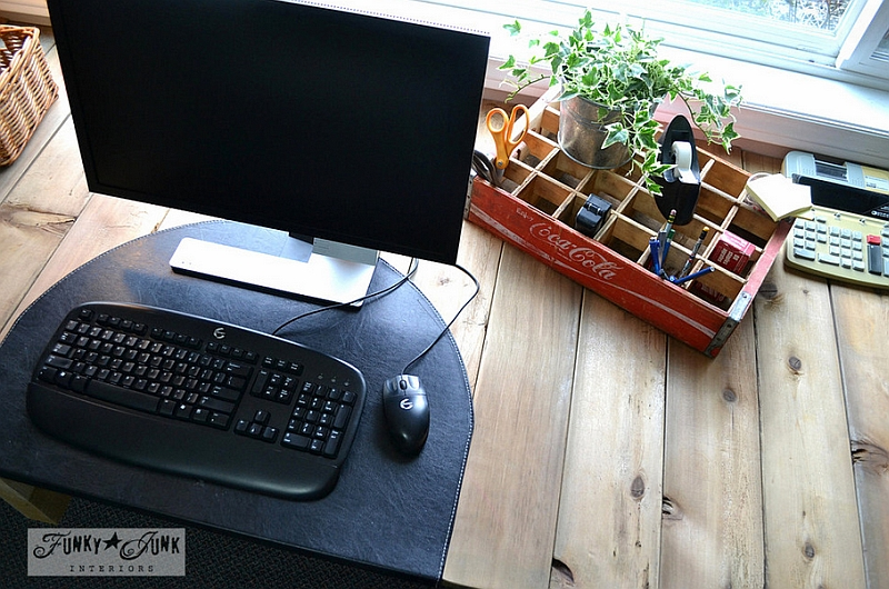 Old Coke crate used as an organizer in the home office