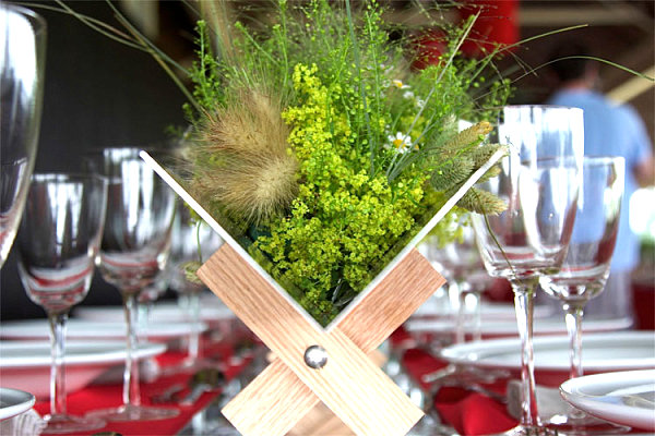 Organic centerpiece on a red tablecloth One Red Tablecloth, Three Table Setting Ideas!