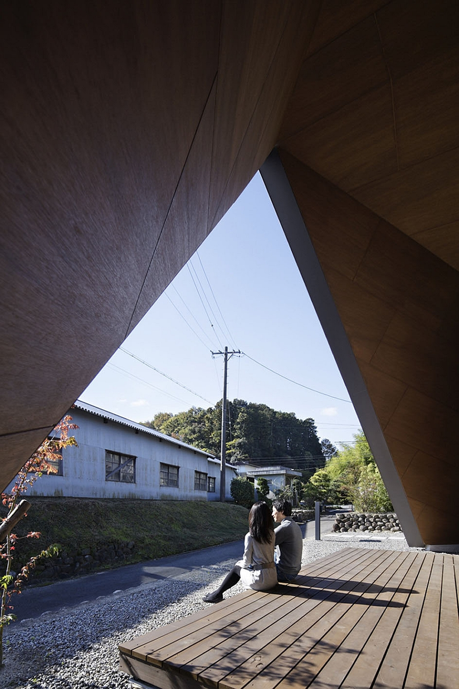 Origami styled, tent-shaped roof offers ample shade to the house