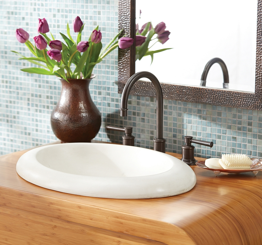 Oval shaped sink in white on a wooden vanity
