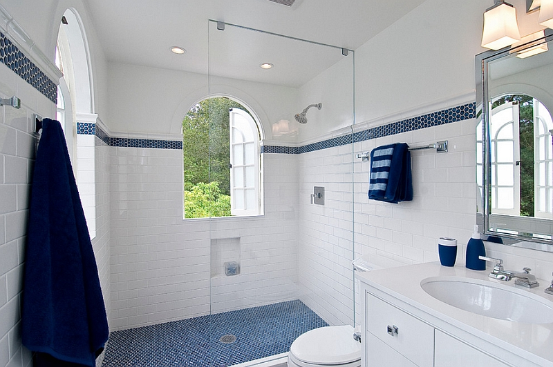 Penny tile floor in the shower area and accent towels for White and blue bathroom ideas
