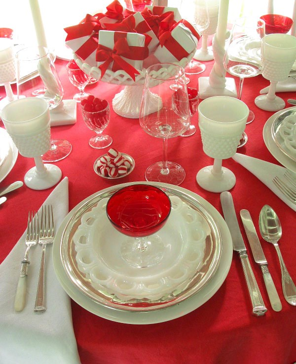 Pepperming and milk glass on a red tablecloth