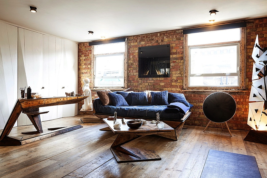 Plush decor in wood and natural fabric creates a soothing and relaxed home Exposed Brick Walls Meet Sustainable Modern Design In Splendid London Apartment