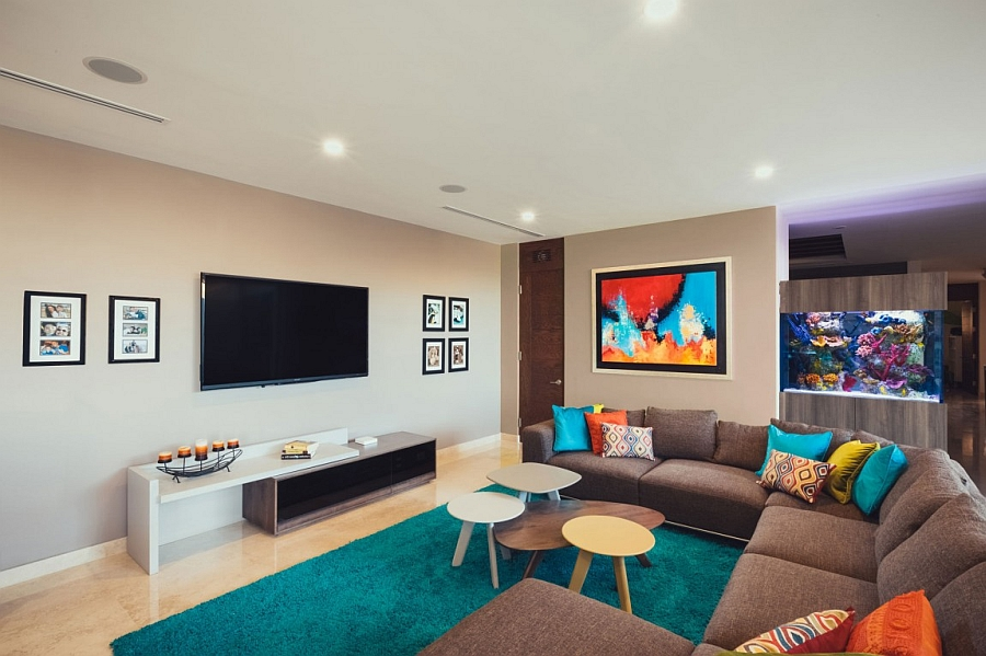 Pops of bright color and the aquarium enliven the family room