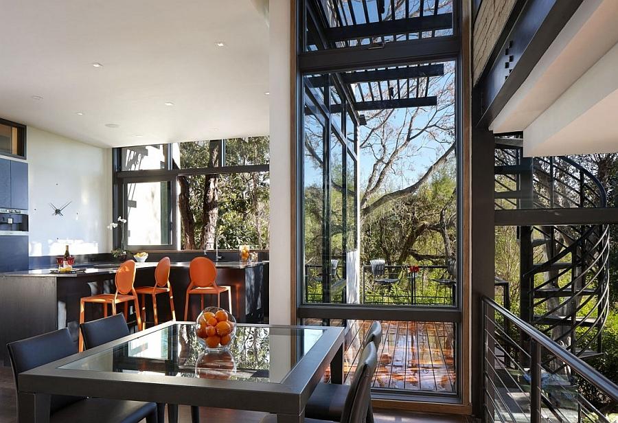 Pops of orange enliven the contemporary interior