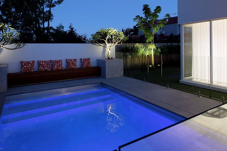 Refrshing pool with smart seating next to it