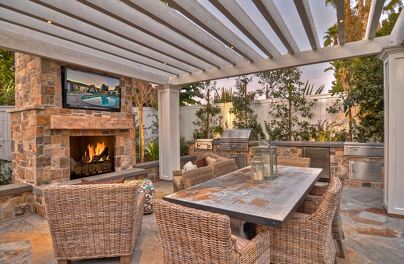 Relaxing outdoor space with a TV above the fireplace