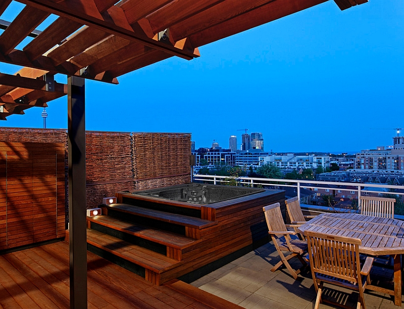 View In Gallery Rooftop Patio With A Hot Tub And Wooden Deck Offers Stunning Views Of Toronto Skyline