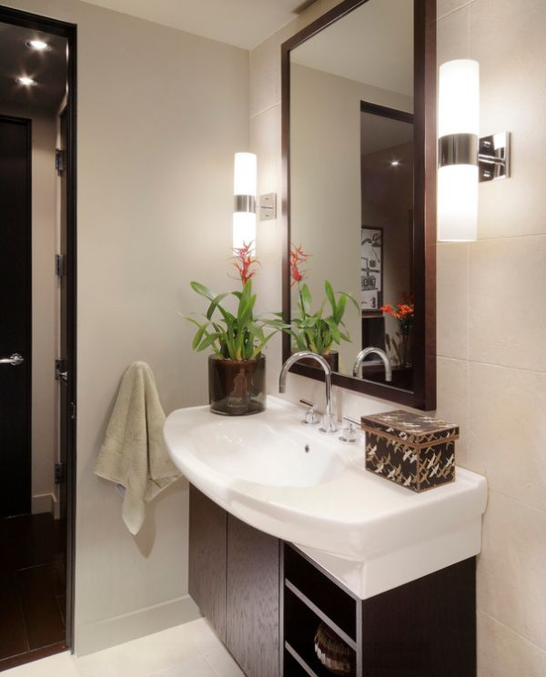View in gallery Sleek and lovely sconce lights next to the mirror in the  bath