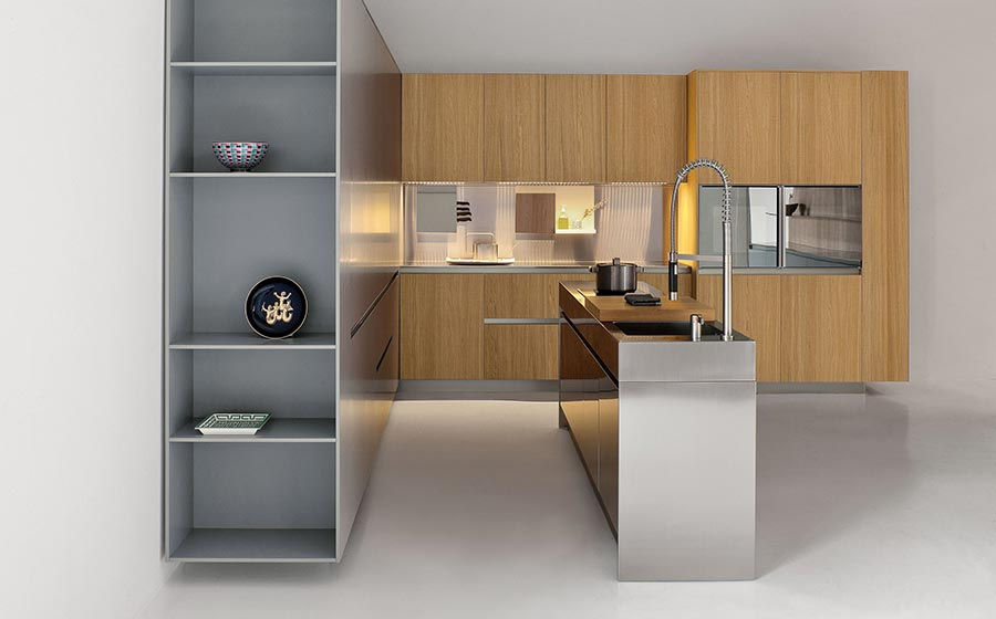 Sleek kitchen island in stainless steel with shelves and cabinets in wood