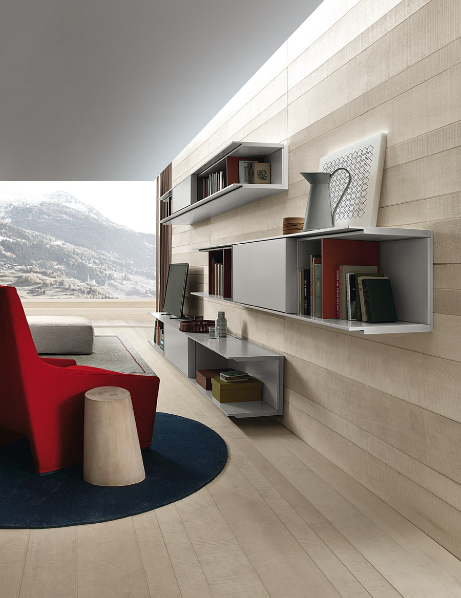 Sleek wall-mounted shelves and closed cabinets make up the living room wall unit