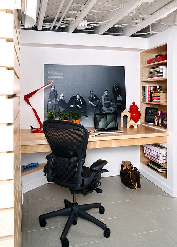 Small basement home office with a built-in desk and smart wall shelves
