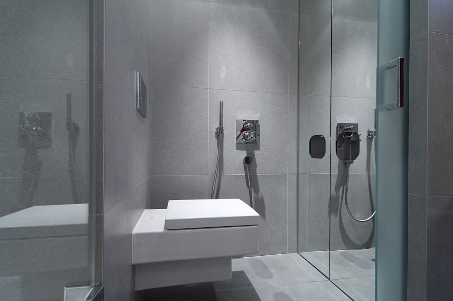 Small bathroom design idea with glass shower enclosure