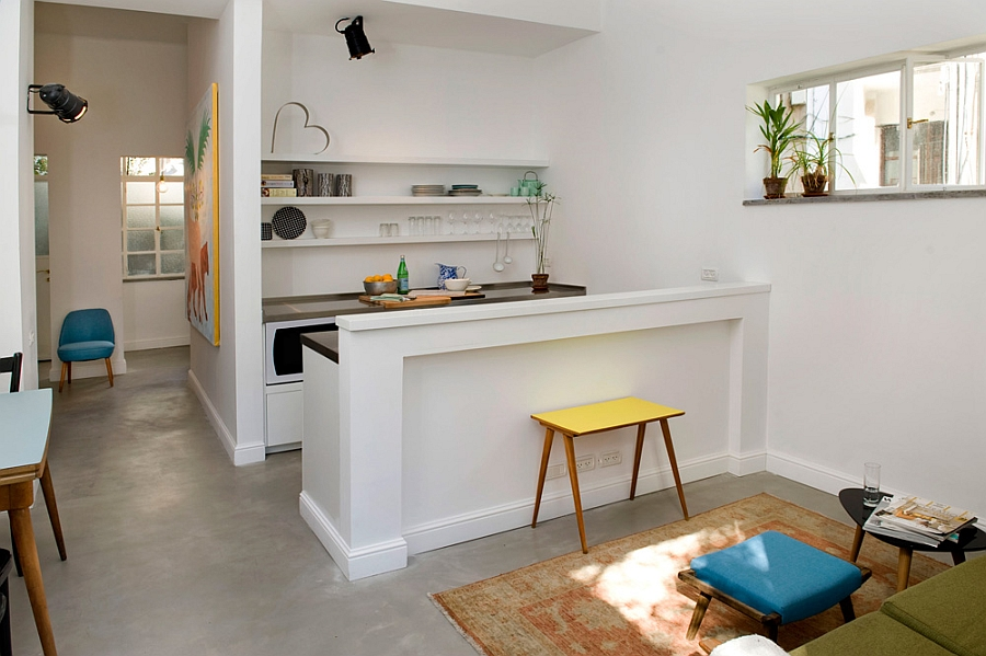 Smart renovation turns old jewelry store into a small for Tiny modern apartment