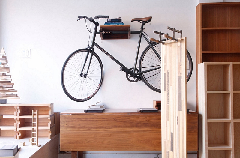 Smart bike holder also offers some additional space for a few books
