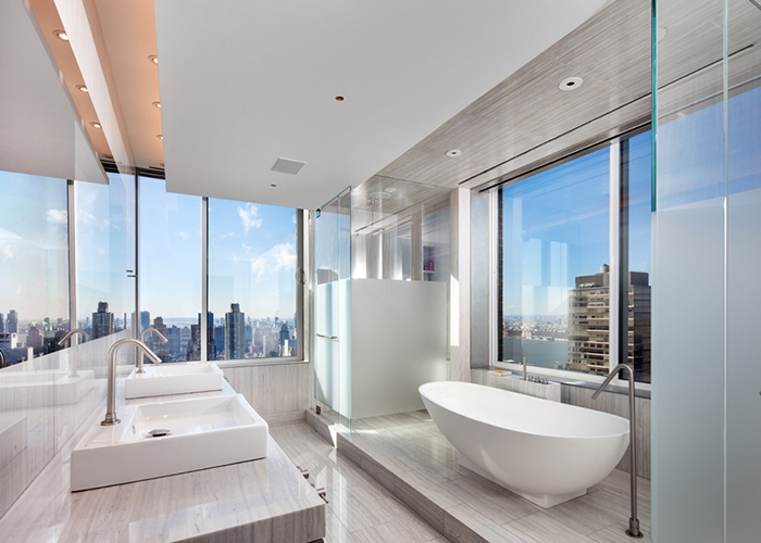 Spa-like contemporary bath in white with NYC skyline views