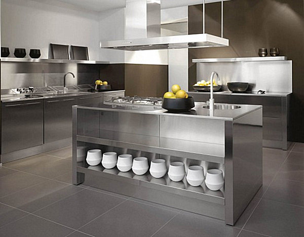 Stainless steel kitchen island with a bowl of fruit on top