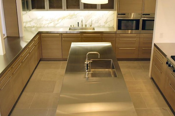 Stainless steel kitchen island with a built-in sink