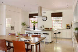 Stainless steel kitchen island with fresh fruit and greenery