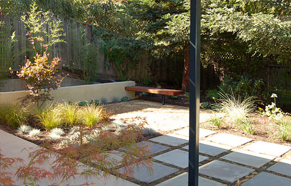 Steel, wood and stone in a backyard space