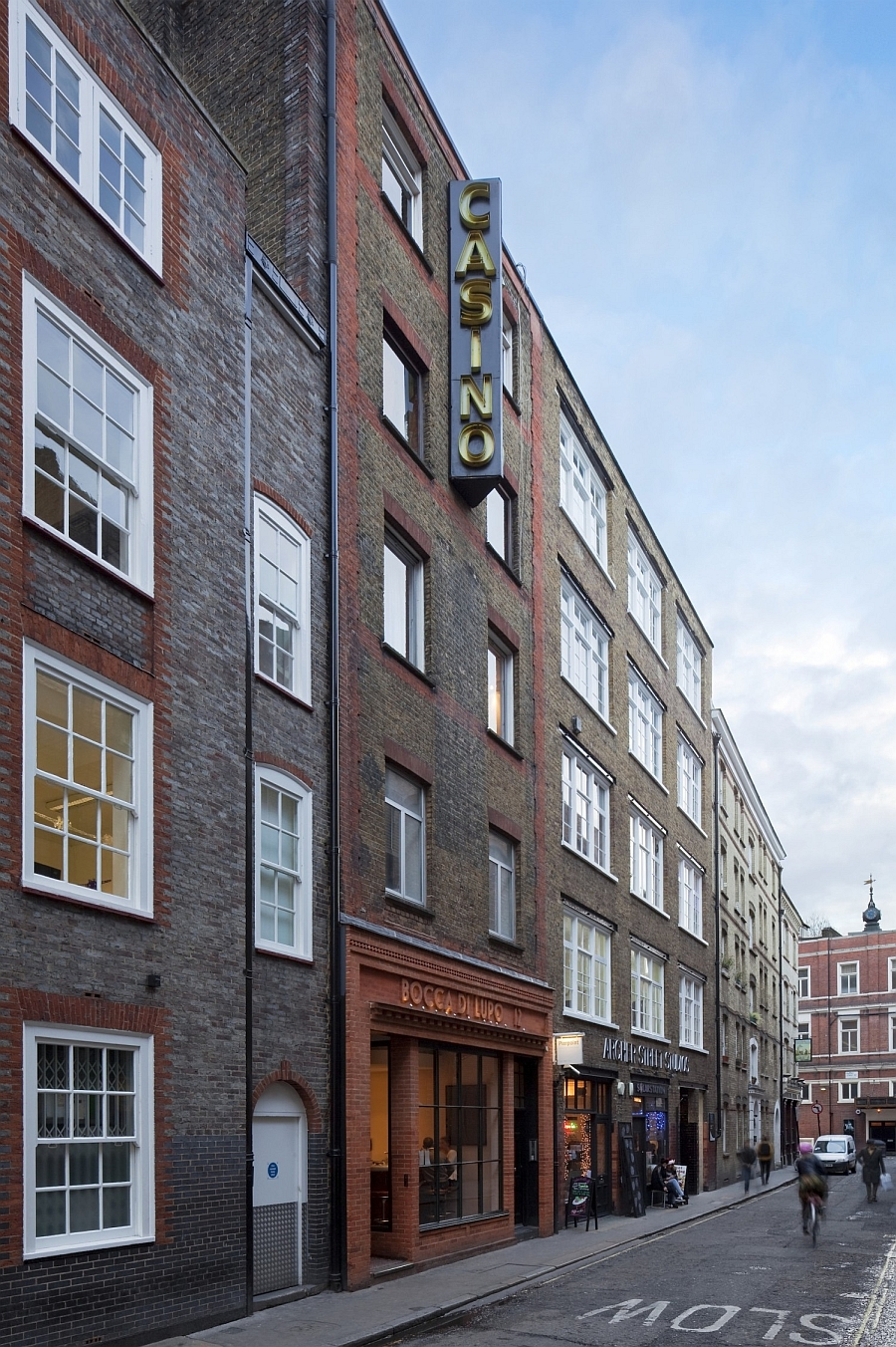 Street facade of the apartment building on Archer Street, Soho, London