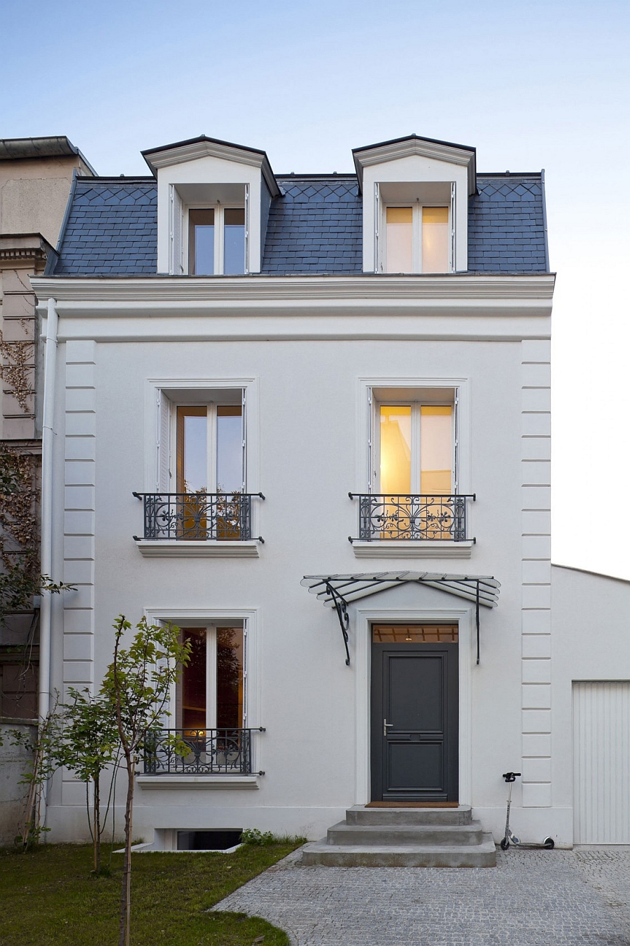traditional french house in vincennes gets a sparkling modern extension. Black Bedroom Furniture Sets. Home Design Ideas