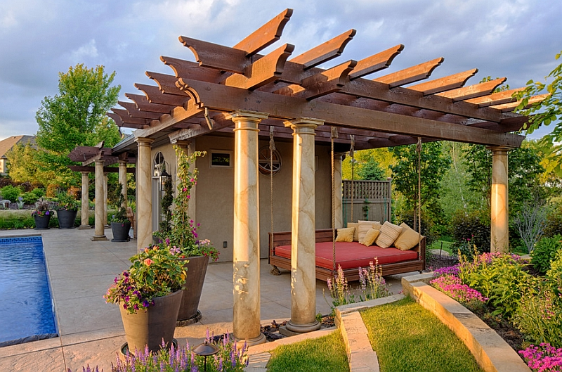 Suspended outdoor bed inside a pergola next to the pool