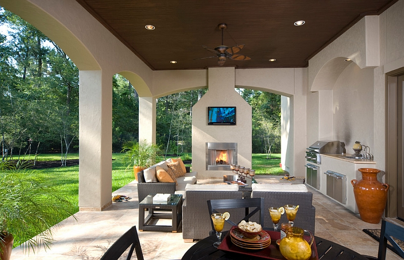 TV above fireplace in the patio is a feature that saves up on space