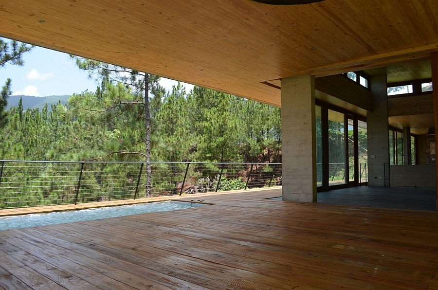 Terrace with a refrshing pool and a lovely view of the secluded woods