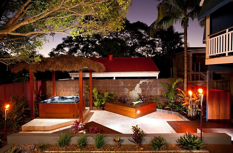 Tiki torches and an outdoor Jacuzzi for an exceptional tropical porch