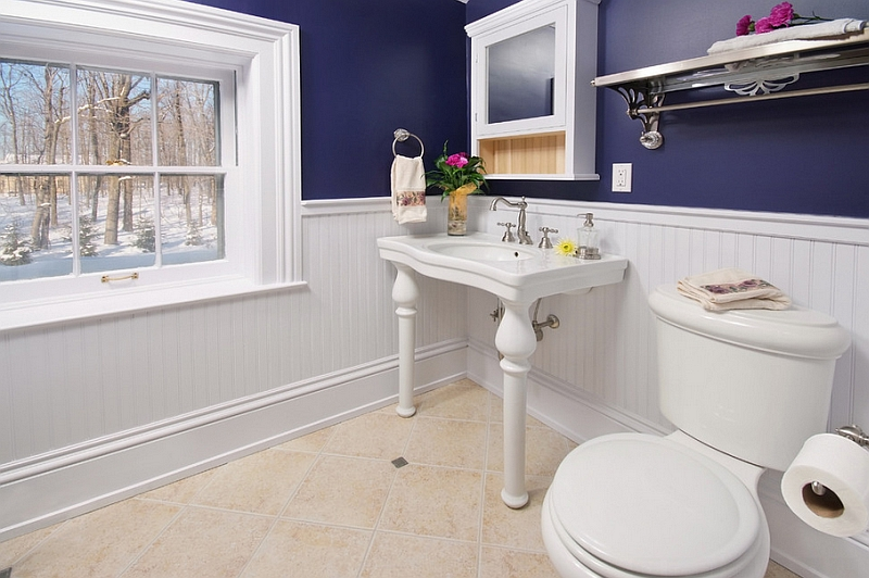 Traditional bathroom looks super cool in bold blue and glossy white