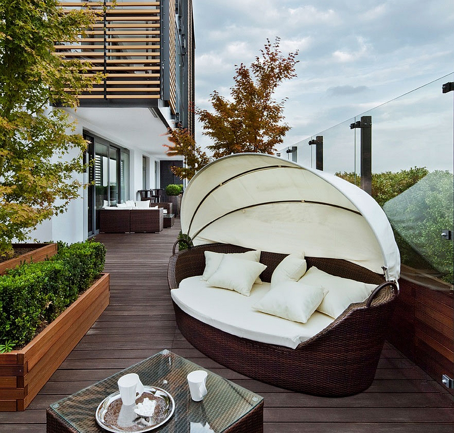 Trendy daybed on the deck of stylish Warsaw apartment