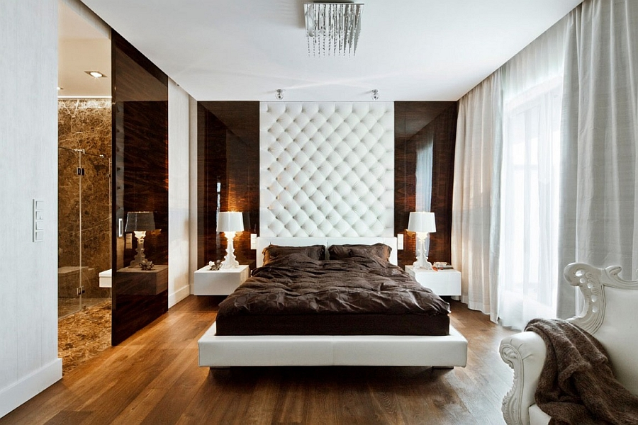 Tufted headboard that extends all the way to the ceiling