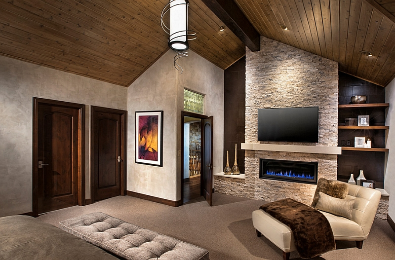Tv above the fireplace idea for the contemporary bedroom