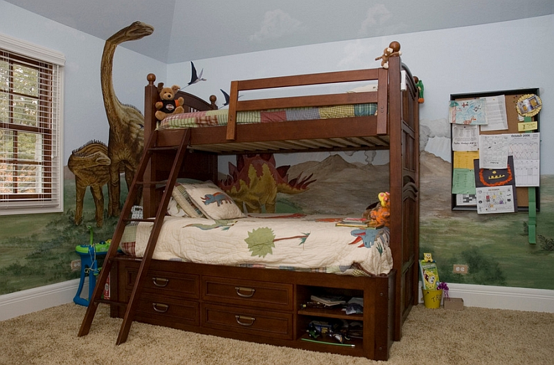 Twin bunk bed with storage in a awesome boys' bedroom with dinosaur theme