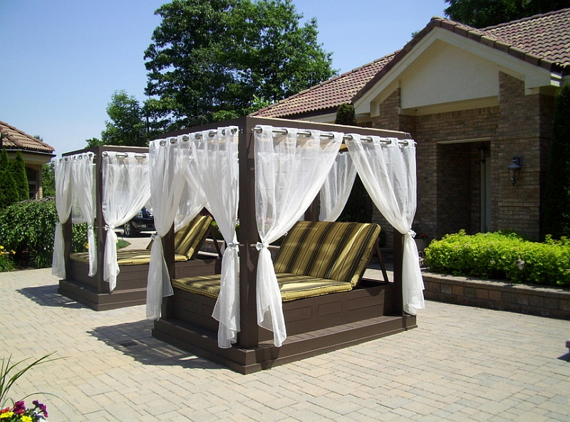 View in gallery Twin poolside canopy beds help beat the summer heat!