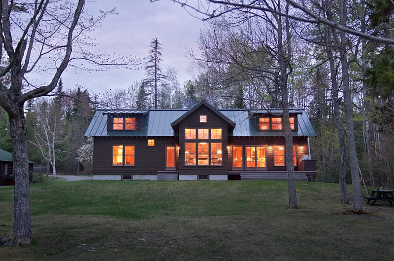 View of the lakeside elevation of the house at dusk