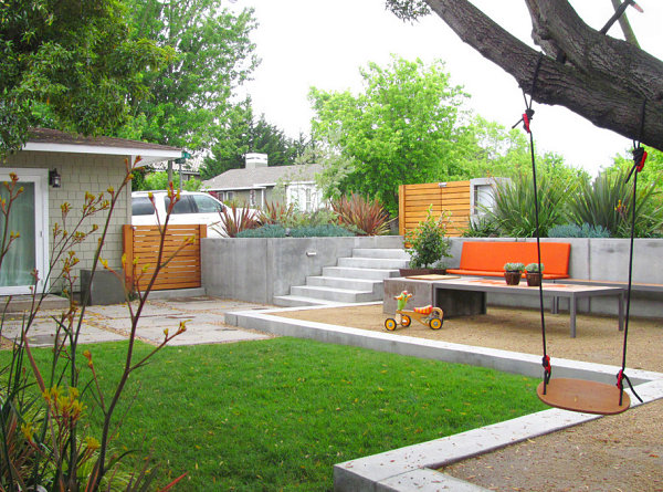 Vivid orange bench in a modern backyard