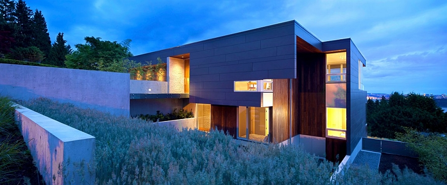 Warm lighting of the house shines through