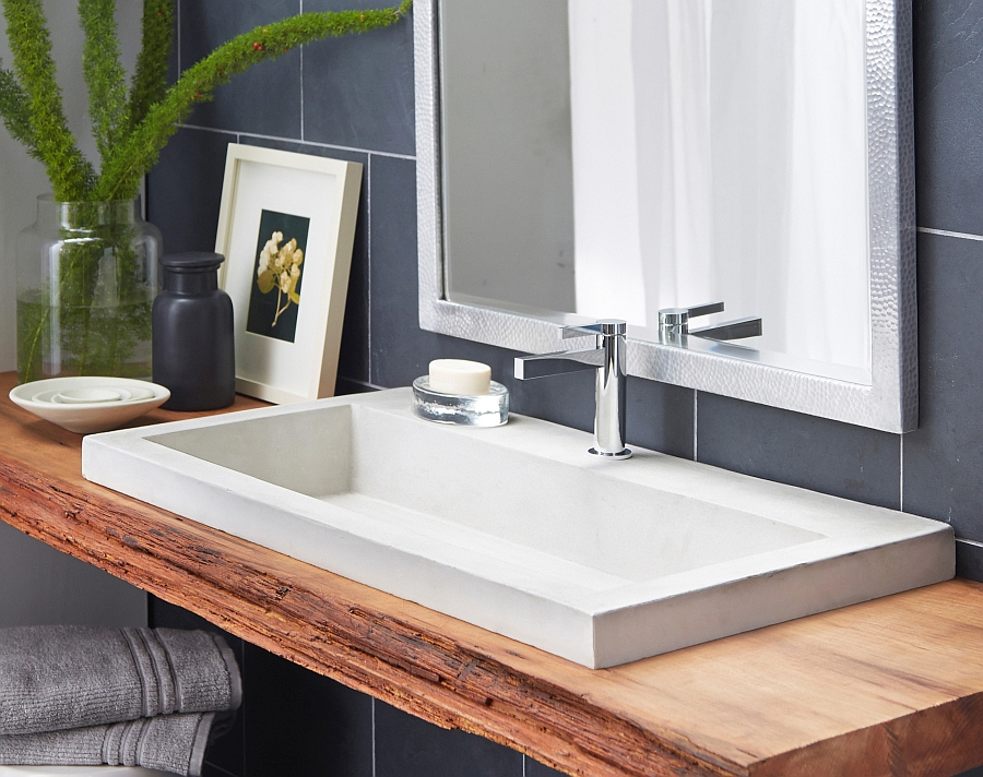 White bathroom sink on a floating wooden vanity