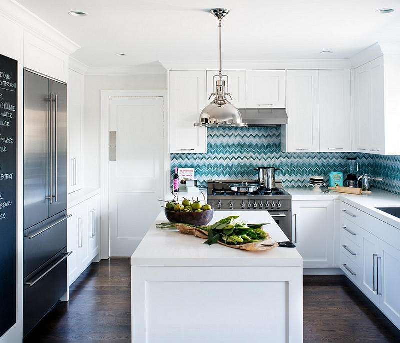 White kitchen with a blue backsplash in vibrant chevron pattern