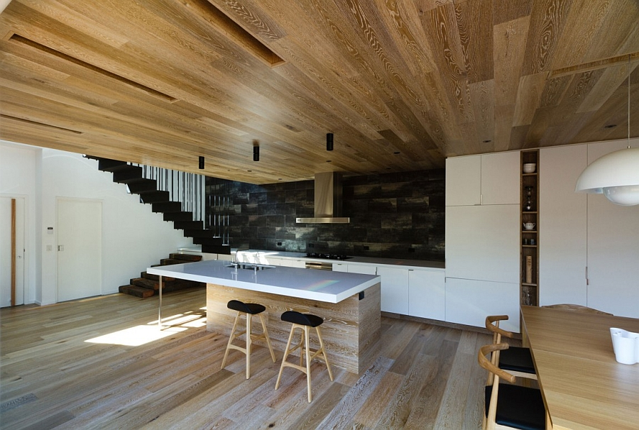 Wooden ceiling and floor give the home a distinct identity