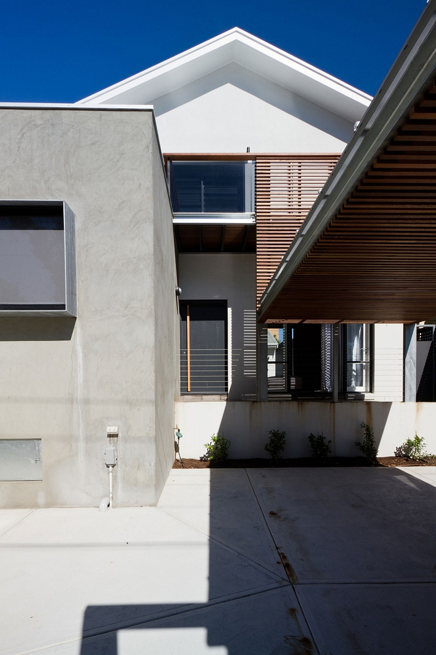 Wooden slats offer both privacy and shade Inviting Open House Down Under Surrounds You With A World Of Wood!