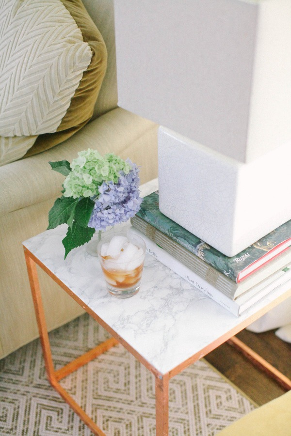 marble and copper contact paper table