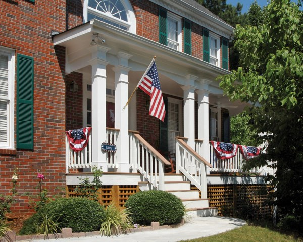 4th of July banner and flag on a front porch