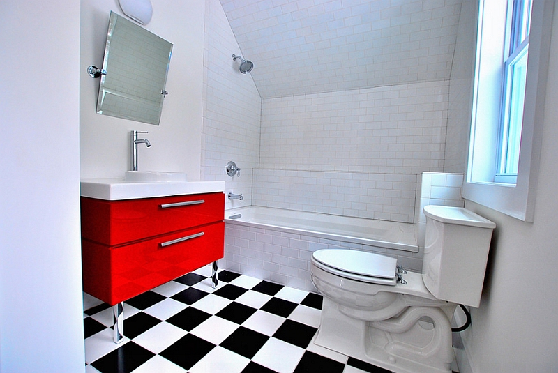 A red vanity in the small bathroom becomes an instant focal point